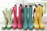 A display of colorful rain boots — Stock Photo