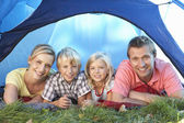 Young family poses in tent — Stock Photo
