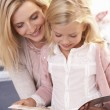 Woman and child reading together — Stock Photo