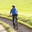 Young woman rides her bike in park — Stock Photo