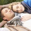 Young couple lying together on grass — Stock Photo #5190593