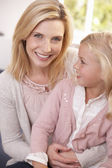 Woman and child pose in studio — Stock Photo