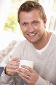 Man drinking from cup — Stock Photo
