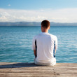 Young man relax watch on ocean — Stock Photo #4492152