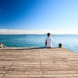 Young man relax watch on ocean — Stock Photo #4492154