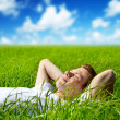 Young man in grass - Stock Photo