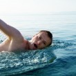 Swiming young man — Stock Photo