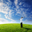 Young man relax on the green field — Stock Photo