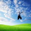 Jumping happy young man — Stock Photo #4492900