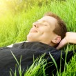 Young man relax in spring grass - Stock Photo