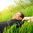 Young man relax in spring grass — Stock Photo #4494613