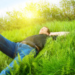 Young man relax in spring grass — Stock Photo