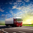 Foto Stock: Truck on highway and sunset