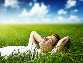 Young man in grass — Foto de Stock
