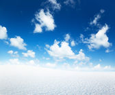 Field of winter snow and perfect blue sky — Stock Photo