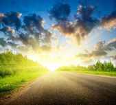 Road and sunset — Stock Photo