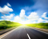 Road and sunny day — Stock Photo