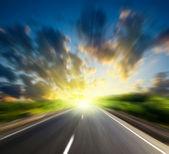 Blur road and sun — Stock Photo