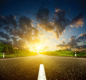 Sunset and roud — Stock Photo