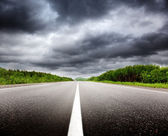 Black clouds and road — Stock Photo