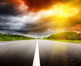 Sunset and road — Stock Photo