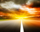 Blur road and dramatic sky — Stock Photo