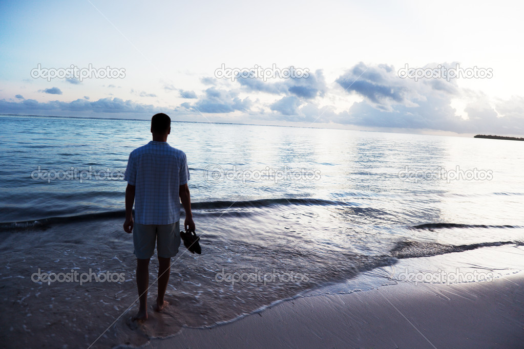 Young man and sunset on Caribbean sea — Stock Photo #4492147