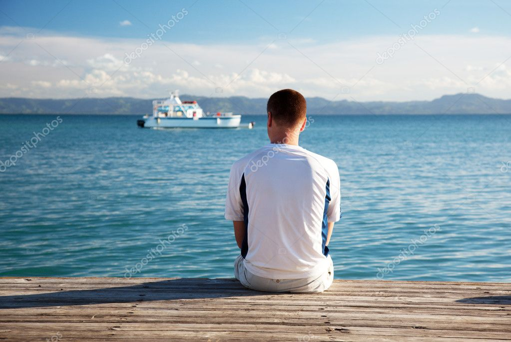 Young man relax siting on pier — Stock Photo #4492178