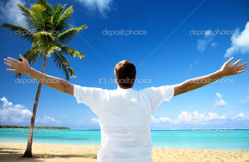 Happy young man on the beach — Stock Photo #4492422
