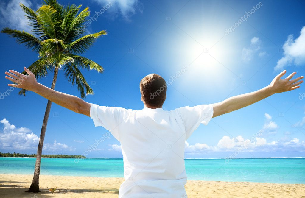 Happy young man on the beach  Stock Photo #4492488