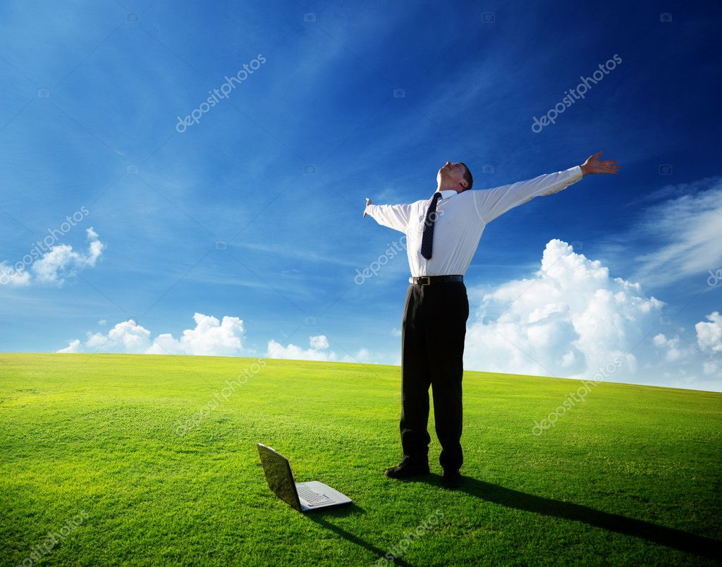 Happy young businessman on spring field — Foto Stock #4493372