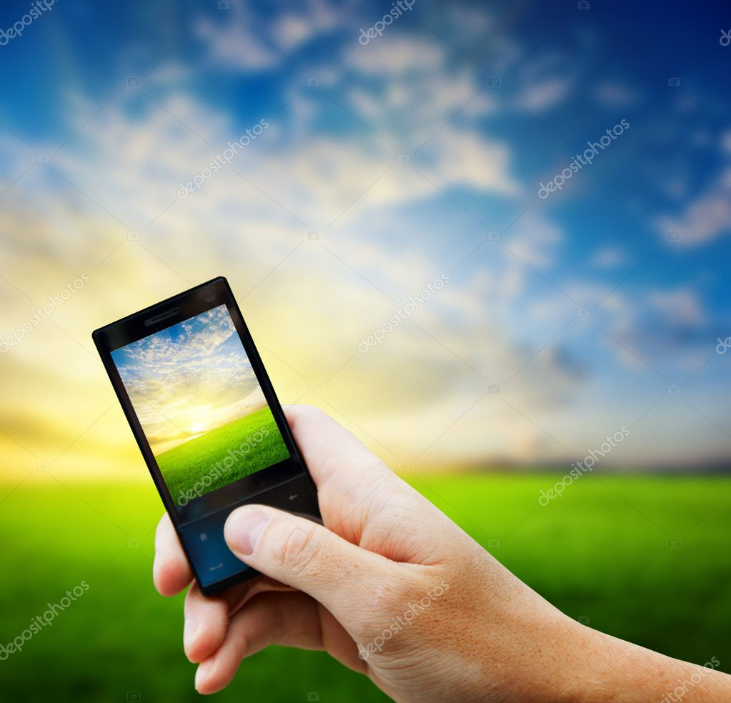 Cell phone in hand and country sunset  Foto Stock #4493496
