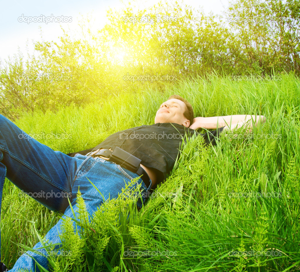 Young man relaxing in spring grass — Stock Photo #4494615