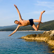 Jump from rock — Stock Photo