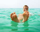 Man in ocean water — Stock Photo