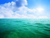 Oceans water and blue sky — Stock Photo