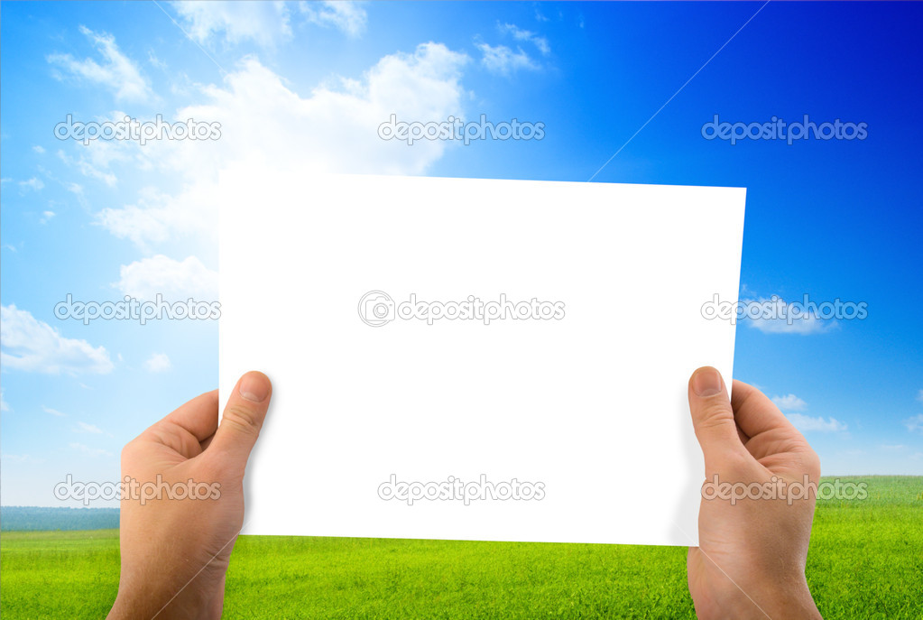 White paper in hands and green field — Stock Photo #4607386