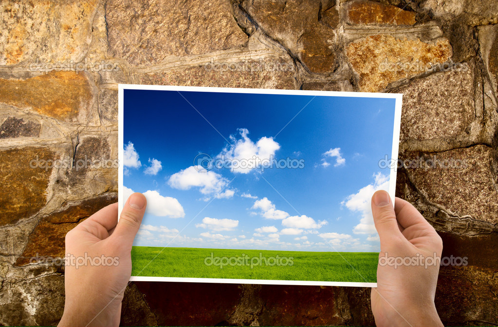 Paper in hands and wall — Stock Photo #4607397
