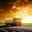 Stock Photo: Truck on highway and sunset
