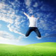 Jumping happy young man — Stock Photo #4621993