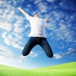 Royalty-Free Stock Photo: Jumping happy young man