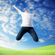 Jumping happy young man — Stock Photo #4622080