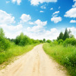 Ground road and summer sunny day — Stock Photo