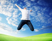 Jumping happy young man — Foto Stock