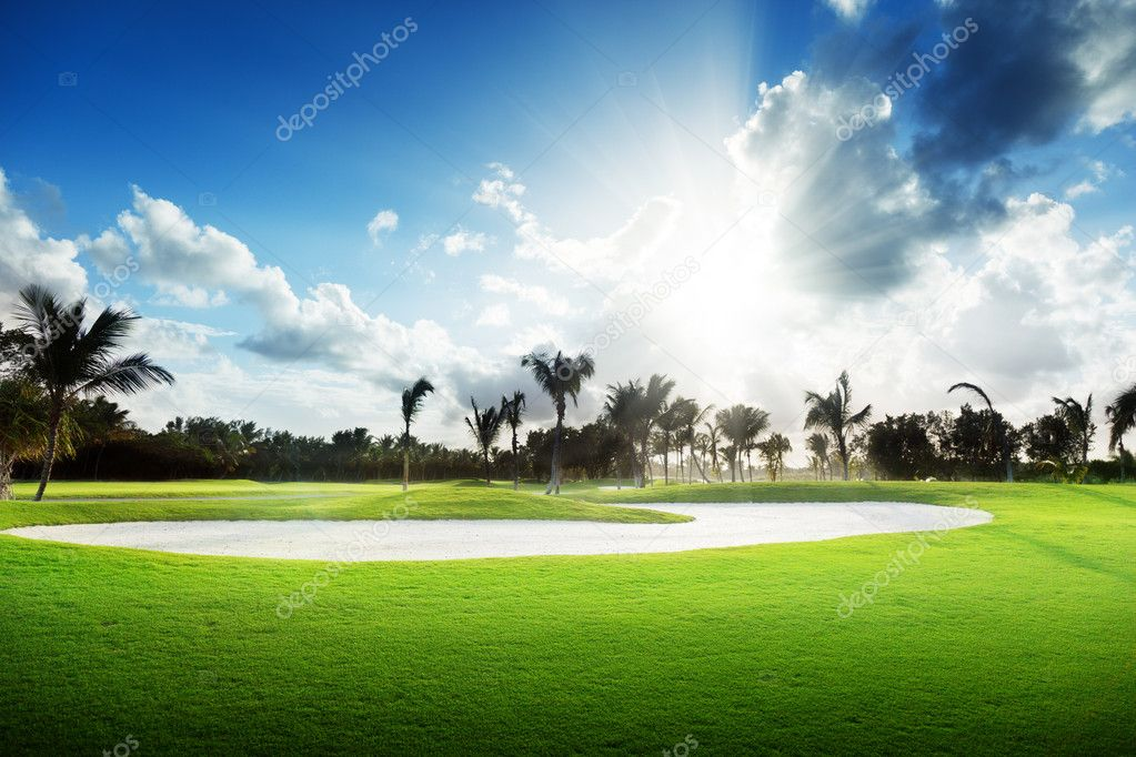 Sunset on golf field — Stock Photo #4621756