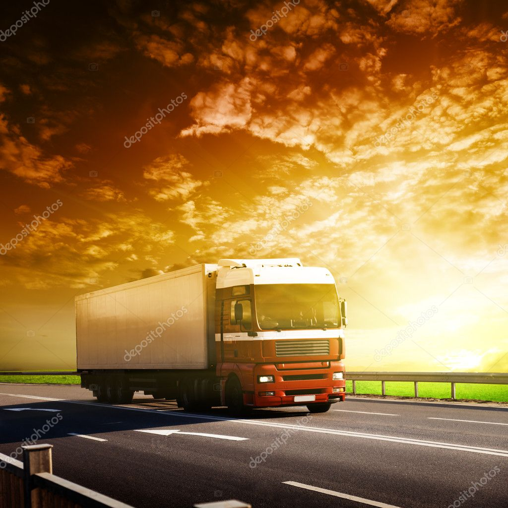Truck on highway and sunset — Stock Photo #4621869