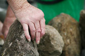 Arthritic hand in the garden — Stock Photo