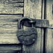 Old lock on a wooden door — Stock Photo