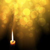 Golden light candles — Stock Photo