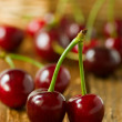 Stock Photo: Fresh cherries on wooden table